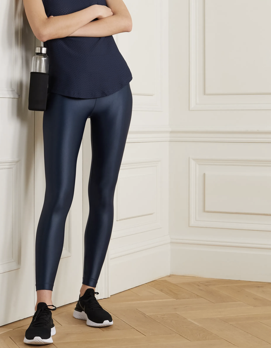 """Don't underestimate Koral's glossy leggings. They make look like they're off-duty-only, but they're made of a flexible stretch fabric that will never sag or get in your way. The minimal seams are also great if you're going for sleek workout look. $80, Net-a-Porter. <a href=""""https://www.net-a-porter.com/en-us/shop/product/koral/lustrous-stretch-leggings/1229882"""" rel=""""nofollow noopener"""" target=""""_blank"""" data-ylk=""""slk:Get it now!"""" class=""""link rapid-noclick-resp"""">Get it now!</a>"""