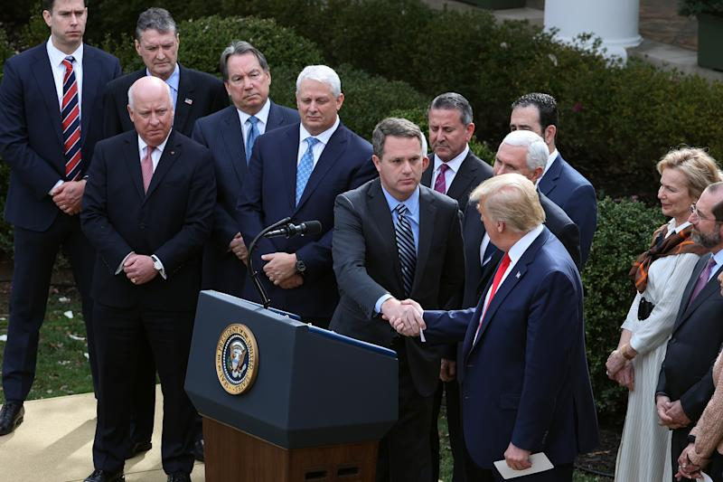 WASHINGTON, DC - MARCH 13: Walmart CEO Doug McMillon shakes hands with U.S. President Donald Trump after he announced the declaration of a national emergency in reaction to the ongoing global coronavirus pandemic in the Rose Garden at the White House March 13, 2020 in Washington, DC. Trump is facing a national health emergency as COVID-19 cases continue to rise and 30 people have died from the virus in the United States, according to The Center for Systems Science and Engineering at Johns Hopkins University. (Photo by Chip Somodevilla/Getty Images)