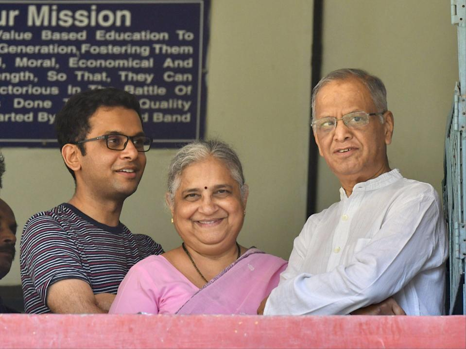 <p>Infosys founder and mentor Narayana Murthy (right), his philanthropist wife Sidha Murthy (centre) and son Rohan Murthy (left)</p> (AFP via Getty Images)