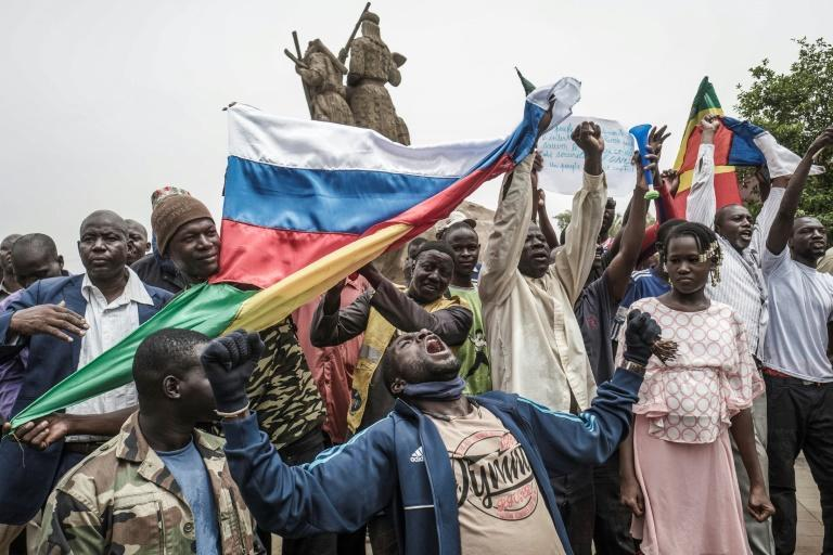 Several hundred people rallied to support the army in a central Bamako square, with Russian flags and portraits of Goita