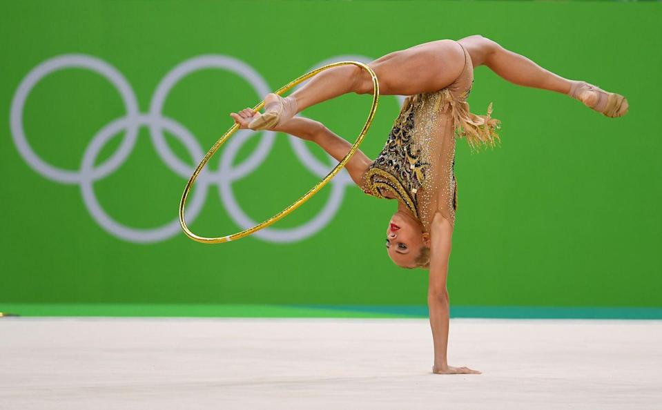 """<p>Throw that hoop or ribbon too high in <a href=""""https://www.buzzfeed.com/annanorth/the-10-most-unusual-rules-of-the-olympic-games"""" rel=""""nofollow noopener"""" target=""""_blank"""" data-ylk=""""slk:rhythmic gymnastics"""" class=""""link rapid-noclick-resp"""">rhythmic gymnastics</a>, and that's too bad. Props can't be retrieved during a routine, and athletes must keep going without them — even if their hoop is in a rafter.</p>"""