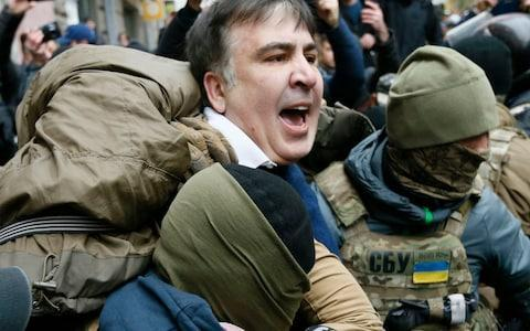 <span>Mr Saakashvili is detained by agents of the security service of Ukraine.</span> <span>Credit: Valentyn Ogirenko/Reuters </span>