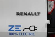 A 100% Electric logo is seen on a Renault Kangoo ZE electric utility vehicle at a Renault automobile dealership in Cagnes-Sur-Mer