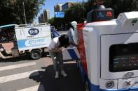 Autonomous delivery vehicle by JD Logistics operates on a street in Beijing