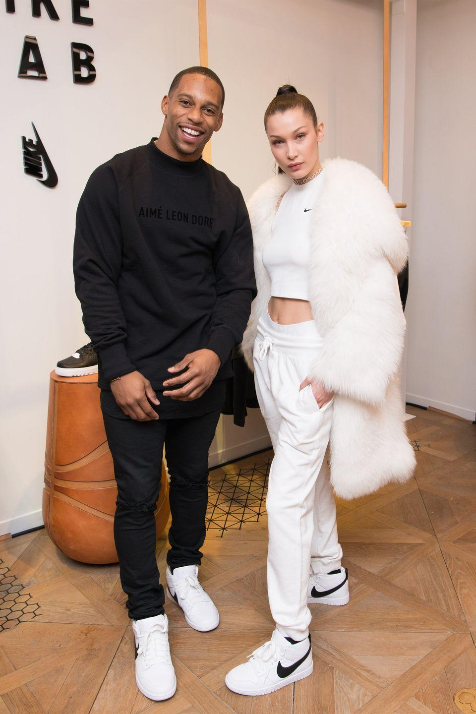 <p>In a white fur coat, Nike crop top, white briefs and sweatpants and Riccardo Tisci x Nike Dunks at the NikeLab opening in NYC with Victor Cruz.</p>