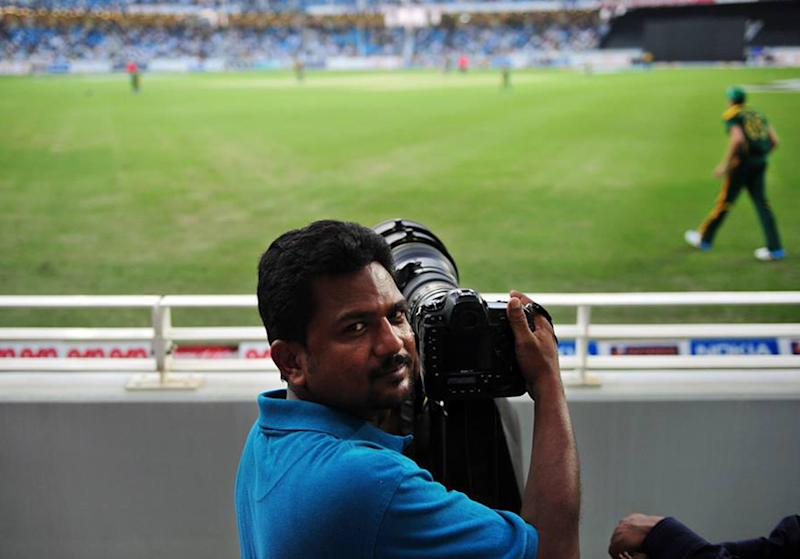 AFP photographer Asif Hassan, pictured while on assignment for the agency in Dubai, in November 2013 (AFP Photo/-)