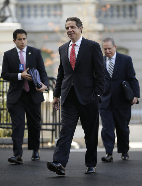 New York Gov. Andrew Cuomo arrives at the West Wing of the White House in Washington, Monday, Dec. 3, 2012, for a scheduled meeting with White House officials. (AP Photo/Pablo Martinez Monsivais)