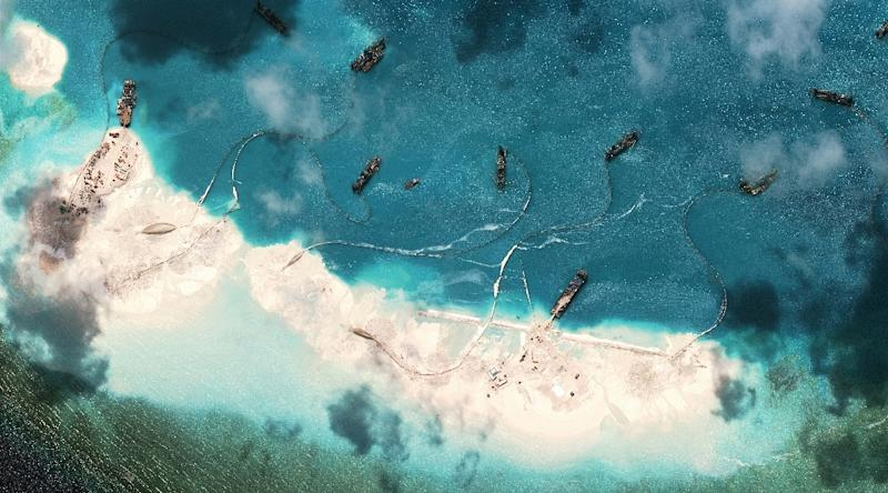 A satellite image of vessels purportedly dredging sand at Mischief Reef in the Spratly Islands in the disputed South China Sea taken by DigitalGlobe for the Asia Maritime Transparency Initiative on March 17, 2015 (AFP Photo/)