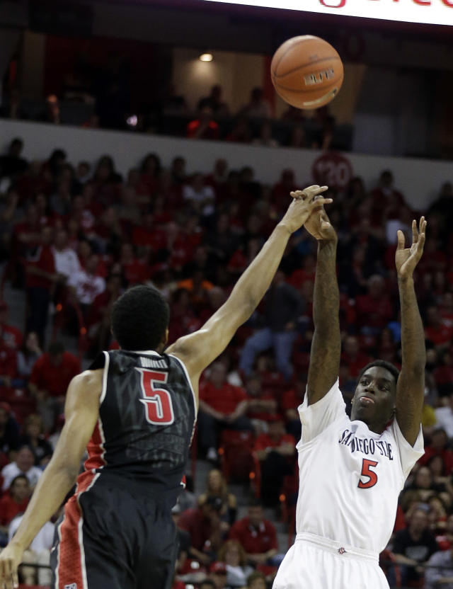 UNLV's Christian Wood covers a shot from San Diego State's Dwayne Polee II during the second half of an NCAA college basketball game in the semifinals of the Mountain West Conference tournament Friday, March 14, 2014, in Las Vegas. San Diego State defeated UNLV 59-51. (AP Photo/Isaac Brekken)