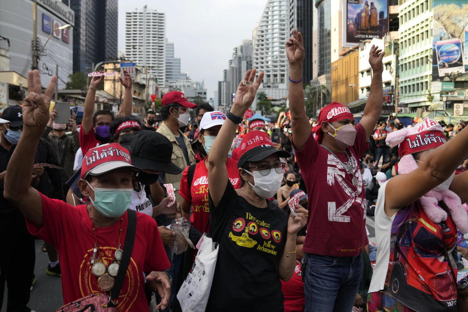 Anti-government protesters display the three-finger symbol of resistance participate in a rally Bangkok, Thailand, Thursday, Sept. 2, 2021. Protesters demanded the resignation of Prime Minister Prayuth Chan-ocha for his failure in handling the COVID-19 pandemic. (AP Photo/Sakchai Lalit)