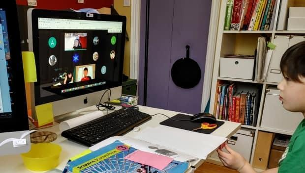 Toronto student Ashton Hall is seen taking part in his hybrid classroom in the fall of 2020. Despite vocal opposition from families, teachers and education experts, the hybrid system is officially back on the tablefor some Ontario boards, after the provinceannounced remote learning would continue. (Submitted by Sandra Huh - image credit)