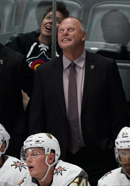 Vegas Golden Knights coach Gerard Gallant smiles during the third period of the team's preseason NHL hockey game against the Colorado Avalanche, Tuesday, Sept. 17, 2019, in Denver. (AP Photo/Jack Dempsey)