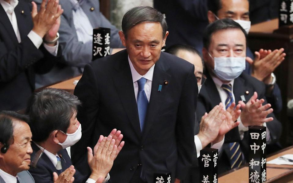 Yoshihide Suga is applauded after being elected as Japan's new prime minister - Koji Sasahara