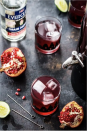 """<p> In a large pitcher, stir together 1/4 cup of cold water, 1/4 cup of superfine sugar, 32 oz. of pomegranate juice, 6 oz. of Everclear, and 1/4 cup of lime juice (about three limes). Chill until you're ready to serve. Then, stir in 24 oz. of ginger beer and enjoy. If you'd like, you can garnish with fresh lime and pomegranate seeds. <em><em><br></em><br>Recipe from <a href=""""https://www.mybakingaddiction.com/pomegranate-ginger-punch/"""" rel=""""nofollow noopener"""" target=""""_blank"""" data-ylk=""""slk:My Baking Addiction."""" class=""""link rapid-noclick-resp"""">My Baking Addiction. </a></em></p>"""