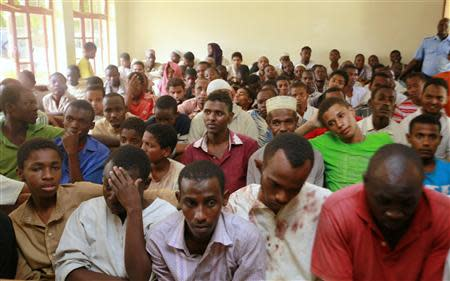Muslims, who were detained by police from Sunday's raid at the Masjid Musa mosque, crowd in a courtroom at Shanzu, a small town along the north coast of Mombasa, February 3, 2014. REUTERS/Joseph Okanga