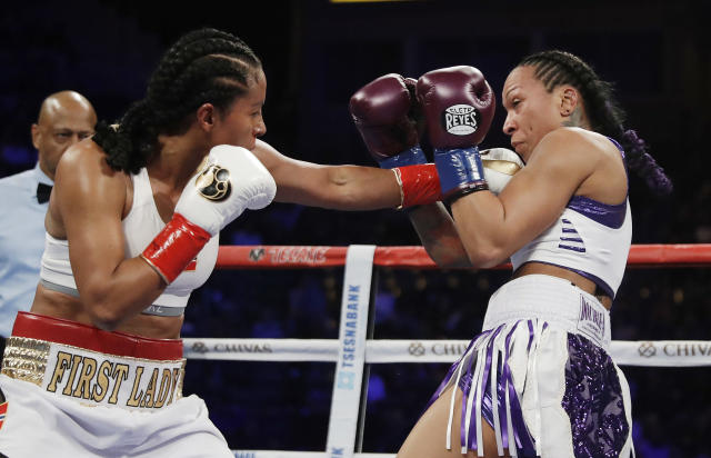 Cecilia Braekhus hits Kali Reis during their female welterweight championship boxing match Saturday in Carson, California. (AP)