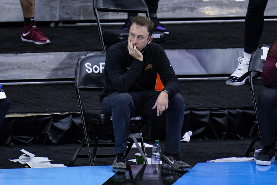 Minnesota head coach Richard Pitino on the bench in the second half of an NCAA college basketball game against Ohio State at the Big Ten Conference tournament in Indianapolis, Thursday, March 11, 2021. (AP Photo/Michael Conroy)