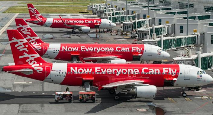 Low-cost Malaysia-based carrier AirAsia has said that around a dozen pilots had called in sick this week, throwing domestic and international flights into disarray (AFP Photo/Mohd Rasfan)