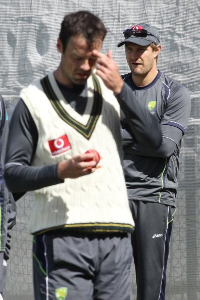 ADELAIDE, AUSTRALIA - NOVEMBER 21: Shane Watson (R) looks on as Rob Quiney prepares to bowl during an Australian training session at Adelaide Oval on November 21, 2012 in Adelaide, Australia.  (Photo by Morne de Klerk/Getty Images)