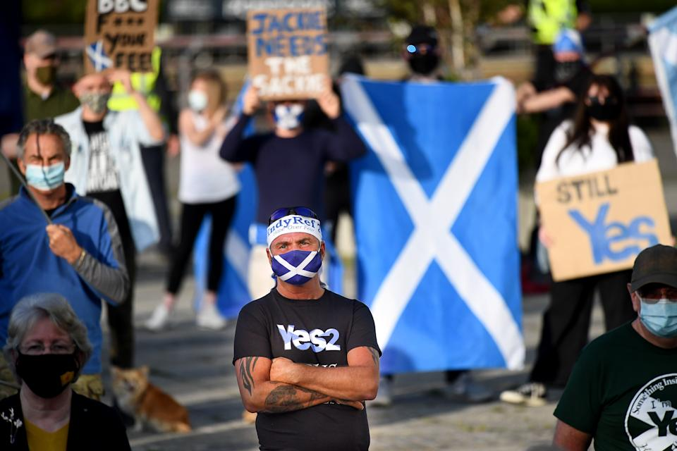 """GLASGOW, SCOTLAND - SEPTEMBER 17: Members of the pro-indy group All Under One Banner hold a rally for independence outside BBC Scotland on September 17, 2020 in Glasgow, Scotland. The group has stated """"we don't just want some more devolution, we want an independence revolution an independent country is our target"""". (Photo by Jeff J Mitchell/Getty Images)"""