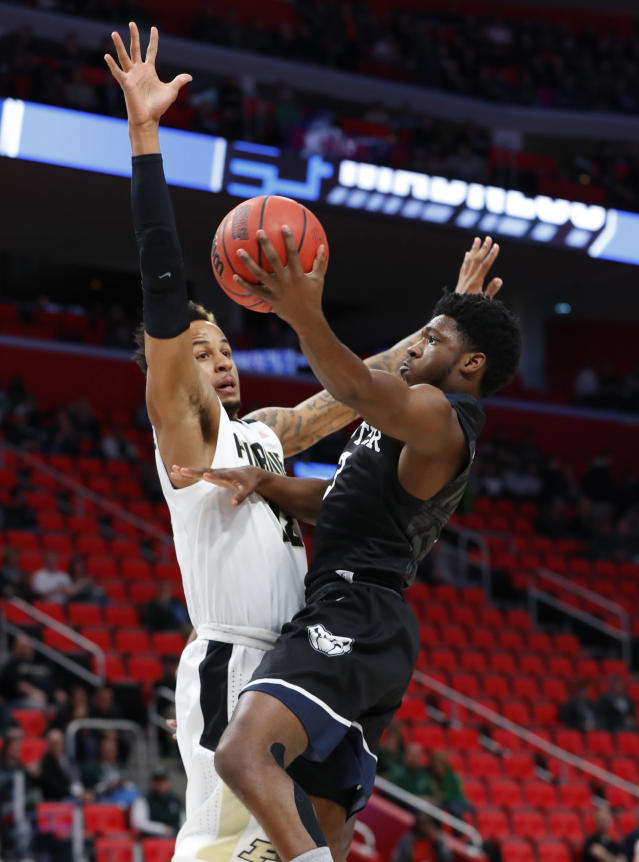 Butler guard Kamar Baldwin (3) drives on Purdue forward Vincent Edwards (12) during the first half of an NCAA men's college basketball tournament second-round game in Detroit, Sunday, March 18, 2018. (AP Photo/Paul Sancya)