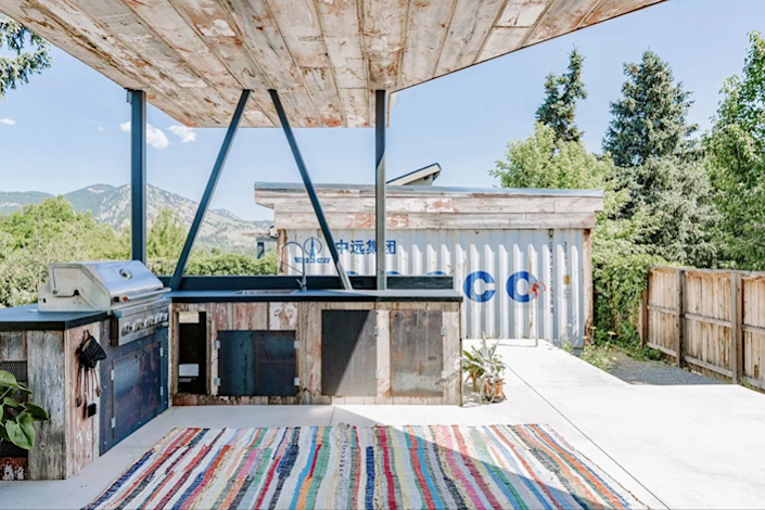 The shipping container home's partially covered patio offers the perfect place to take in the views and grill.