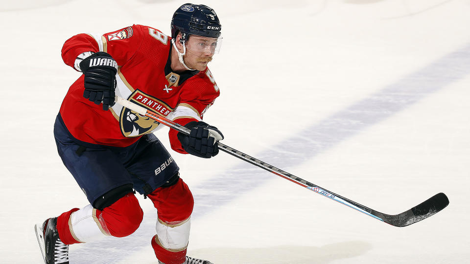 SUNRISE, FL - MAY 16: Sam Bennett #9 of the Florida Panthers passes the puck against the Tampa Bay Lightning in Game One of the First Round of the 2021 Stanley Cup Playoffs at the BB&T Center on May 16, 2021 in Sunrise, Florida. (Photo by Eliot J. Schechter/NHLI via Getty Images)
