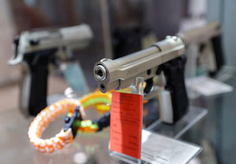 Gas pistols are displayed at a Hungarian gun shop where people queued up to buy weapons for protection amid the coronavirus pandemic