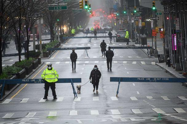 PHOTO: People are seen wearing protective face masks while walking in Park Avenue as part of NYC's 'Open Streets', which closes some streets to vehicle traffic to allow more space for pedestrians. (Noam Galai/Getty Images)