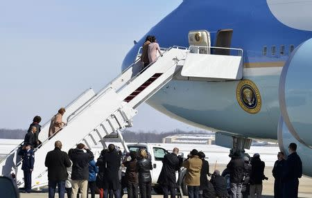 (L-R) U.S. President Barack Obama and first lady Michelle Obama walk up the ramp with Michelle Obama's mother Marian Robinson and their daughters Sasha and Malia as they board Air Force One for departure from Joint Base Andrews, Maryland for a day trip to Selma, Alabama, March 7, 2015. REUTERS/Mike Theiler