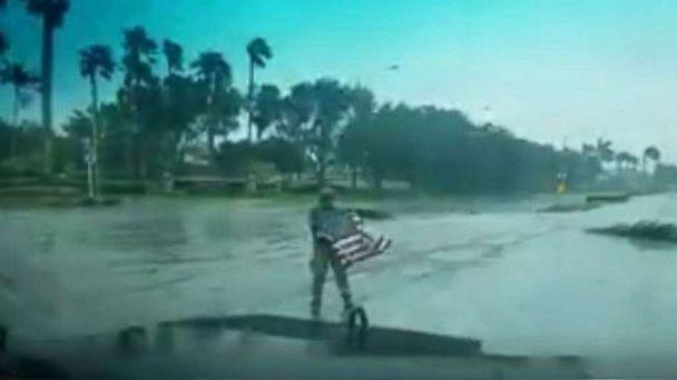 PHOTO: First responder Joseph Schiavo picks up a fallen flag while patrolling in Coral Springs, Florida, after Hurricane Irma hit the area, Sept. 10, 2017. (Coral Springs Police Dept.)