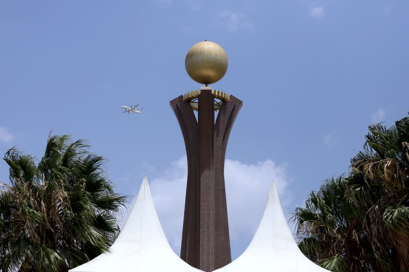 FILE PHOTO: Plane flies next to Tigray Martyrs' monument during the funeral ceremony of Ethiopia's Army Chief of Staff Seare Mekonnen in Mekele