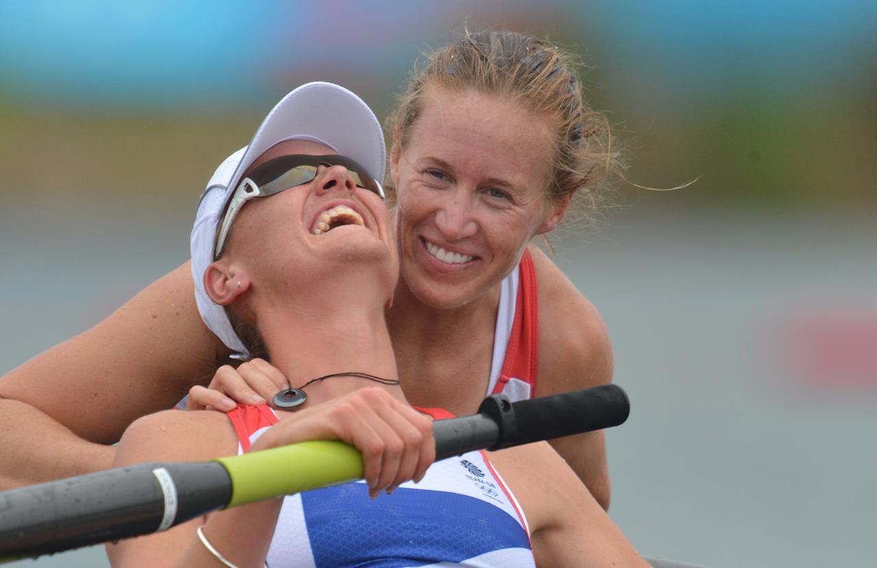 WINDSOR, ENGLAND - AUGUST 01:  Helen Glover and Heather Stanning of Great Britain celebrate in their boat  after winning gold in the Women's Pair Final A on Day 5 of the London 2012 Olympic Games at Eton Dorney on August 1, 2012 in Windsor, England. (Photo by Eric Feferberg - IOPP Pool / Getty Images)