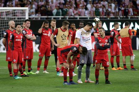 Soccer Football - CONCACAF Champions League Final Second Leg - Guadalajara vs Toronto FC - Estadio Akron, Guadalajara, Mexico - April 25, 2018 Toronto players look dejected after the match REUTERS/Henry Romero