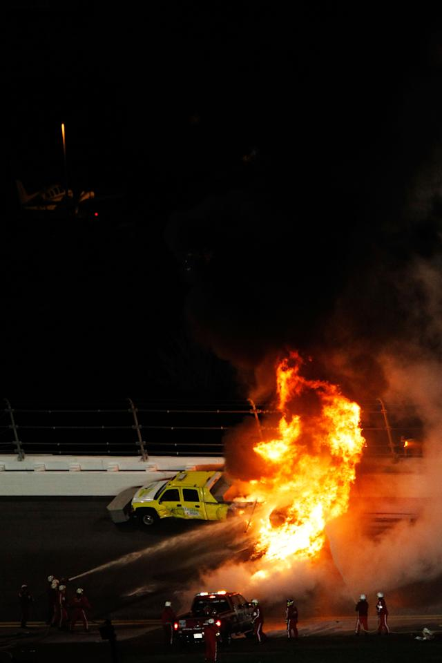 DAYTONA BEACH, FL - FEBRUARY 27:  Safety workers try to extinguish a fire from a jet dryer after being hit by Juan Pablo Montoya, driver of the #42 Target Chevrolet, under caution during the NASCAR Sprint Cup Series Daytona 500 at Daytona International Speedway on February 27, 2012 in Daytona Beach, Florida.  (Photo by Tom Pennington/Getty Images for NASCAR)