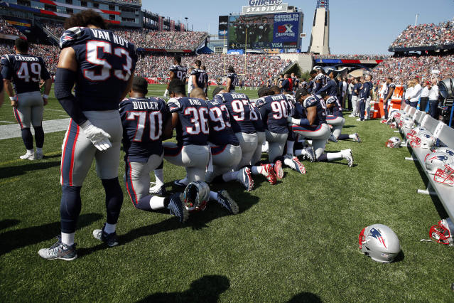 <p>Several New England Patriots players kneel during the national anthem before an NFL football game against the Houston Texans, Sept. 24, 2017, in Foxborough, Mass. (Photo: Michael Dwyer/AP) </p>