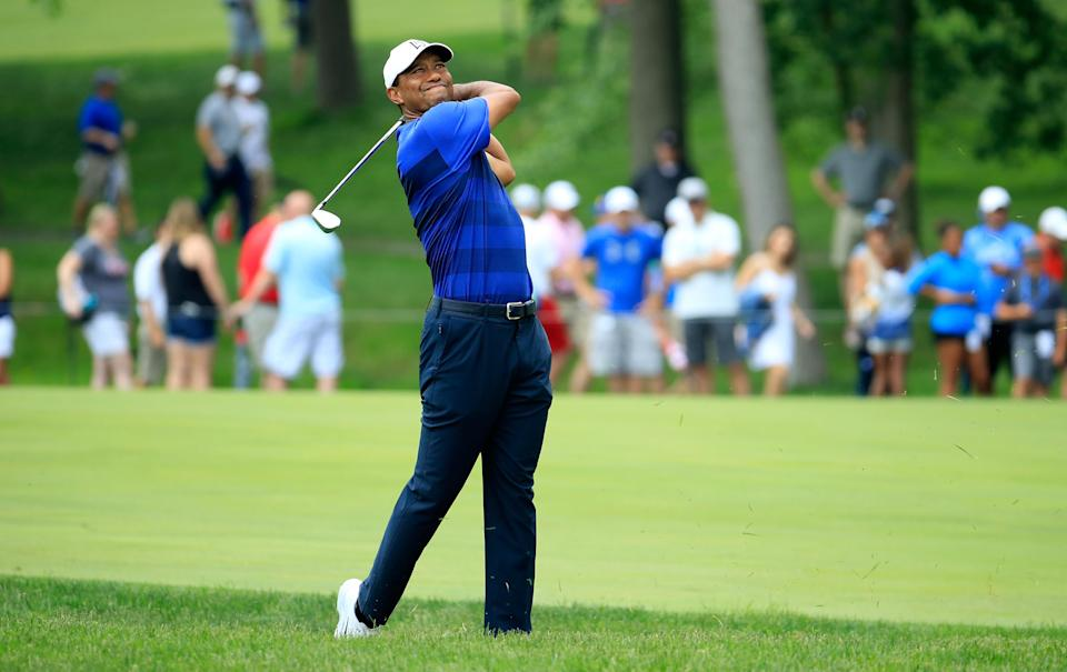 Tiger Woods holed out for an eagle on No. 11 on Friday at the Memorial Tournament at Murifield Village in Dublin, Ohio. The crowd, naturally, went crazy. (Getty Images)