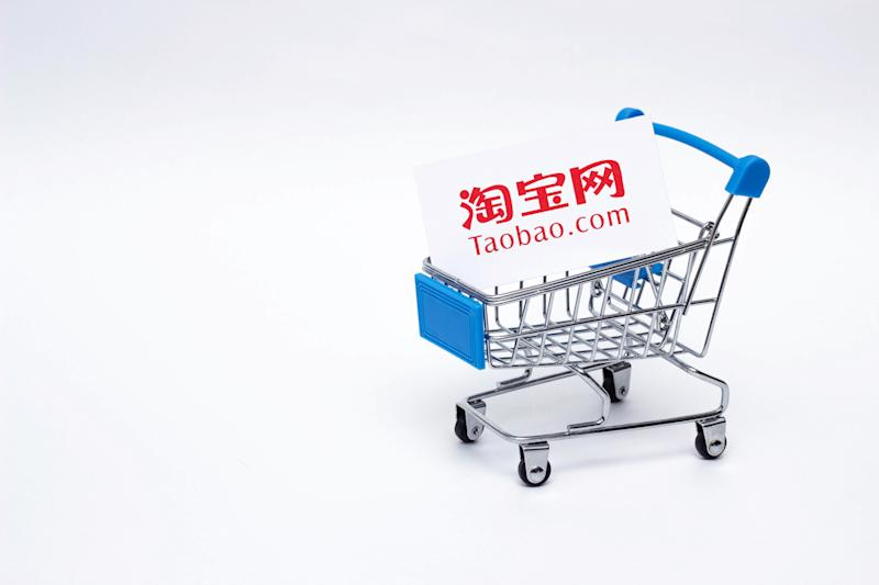 BOBRUISK, BELARUS - JANUARY 30, 2019: Shopping trolley on a white background online store, marketplace TAOBAO, transaction