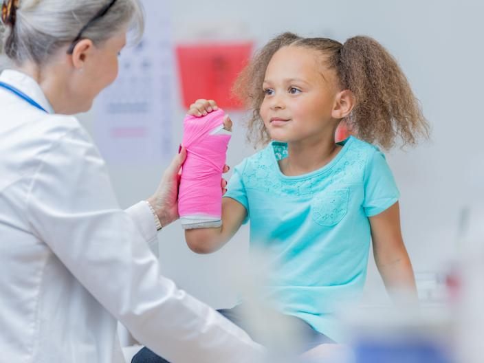 A stock photo of a child at a doctor's office.