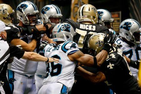Dec 7, 2014; New Orleans, LA, USA; Carolina Panthers tight end Brandon Williams (86) fights with New Orleans Saints defensive end Cameron Jordan (94) during the first quarter of a game at the Mercedes-Benz Superdome. Williams was ejected from the game due to the fight. Mandatory Credit: Derick E. Hingle-USA TODAY Sports