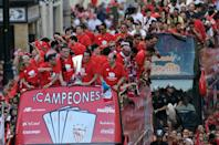 Sevilla team parade on top of a bus by a street of Sevilla to celebrate their victory in the 2015 Europa League final (CRISTINA QUICLER/AFP/Getty Images)