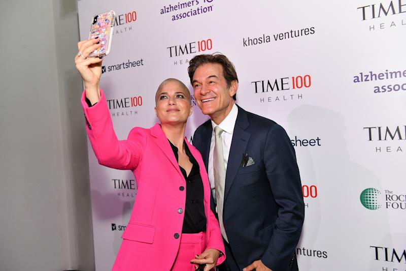 Actor Selma Blair (L) and and Dr. Mehmet Oz arrive at the TIME 100 Health Summit at Pier 17 in New York City on Oct. 17, 2019. | Craig Barritt—Getty Images for TIME 100 Health