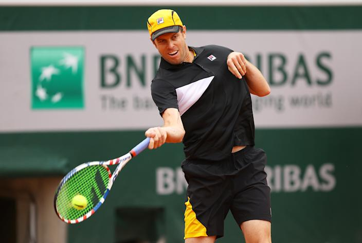 PARIS, FRANCE - SEPTEMBER 29: Sam Querrey of the United States plays a forehand during his Men's Singles first round match against Andrey Rublev of Russia on day three of the 2020 French Open at Roland Garros on September 29, 2020 in Paris, France. (Photo by Julian Finney/Getty Images)