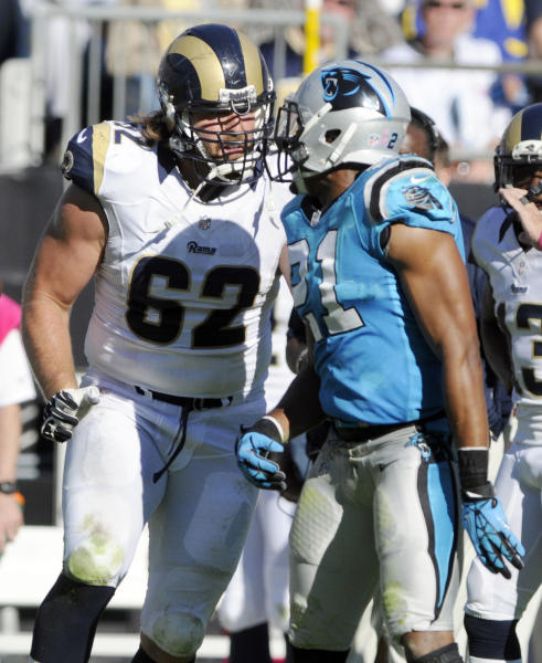 St. Louis Rams' Harvey Dahl (62) confronts Carolina Panthers' Mike Mitchell (21) in the second half of an NFL football game in Charlotte, N.C., Sunday, Oct. 20, 2013. Dahl was called for a personal foul on the play. (AP Photo/Mike McCarn)