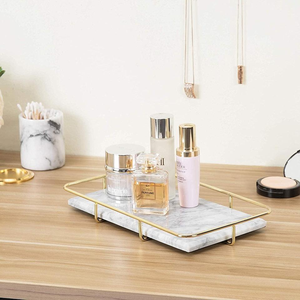 <p>You can never go wrong with this Instagram worthy <span>MyGift Marble Vanity Organizer Tray with Polished Gold-Tone Metal Rail</span> ($33).</p>