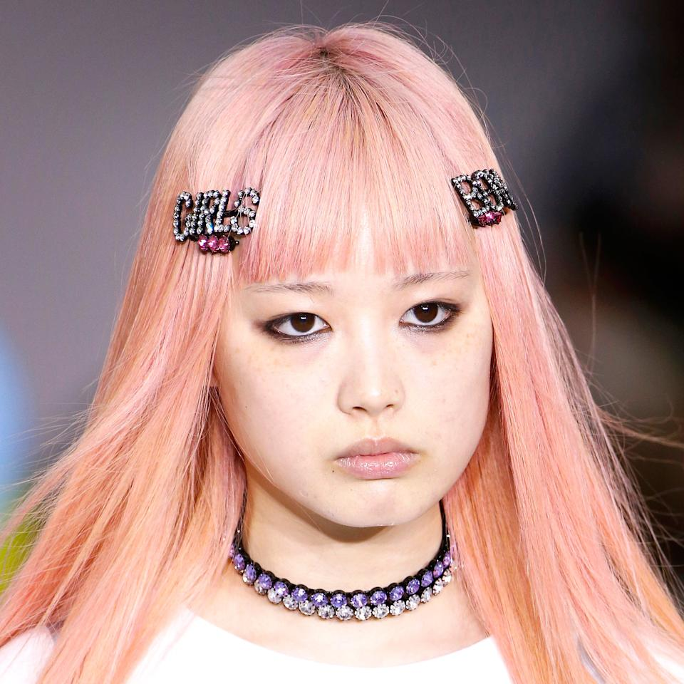 "<p>Cyndi Lauper provided inspiration for the youthful, playful look at Ashley Williams, where models had their hair straightened or crimped and wore pins spelling out ""girls"" and ""boys"" in rhinestone letters. (We think the barrettes look would be great on both.)</p>"