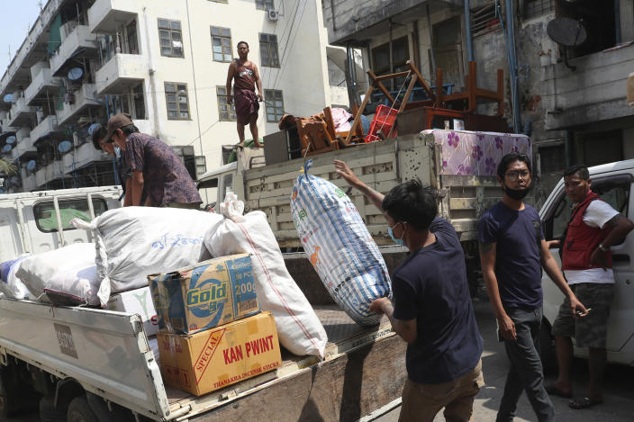 State railway employee load belongings after being evicted from their homes Saturday, March 20, 2021, in Mandalay, Myanmar. State railway workers in Mandalay have been threatened with eviction to force them to end their support for the Civil Disobedience Movement (CDM) against military rule. (AP Photo)