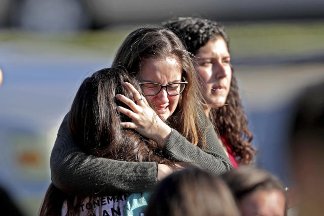 <p>Students released from a lockdown embrace following following a shooting at Marjory Stoneman Douglas High School in Parkland, Fla., Feb. 14, 2018. (Photo: John McCall/South Florida Sun-Sentinel via AP) </p>