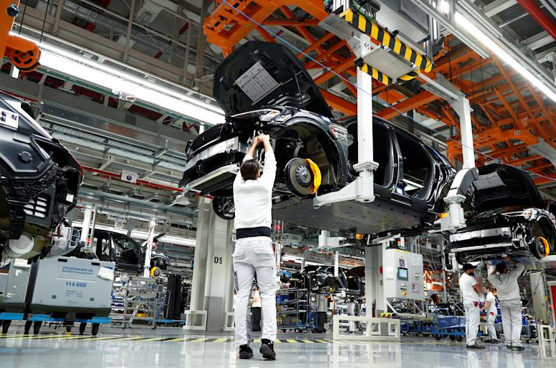Workers at Audi e-tron production line at its Brussels assembly plant, Belgium. Photo: Francois Lenoir/Reuters