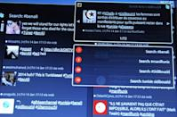 A computer screen shows tweets posted by users on January 14, 2011 about the situation in Tunisia